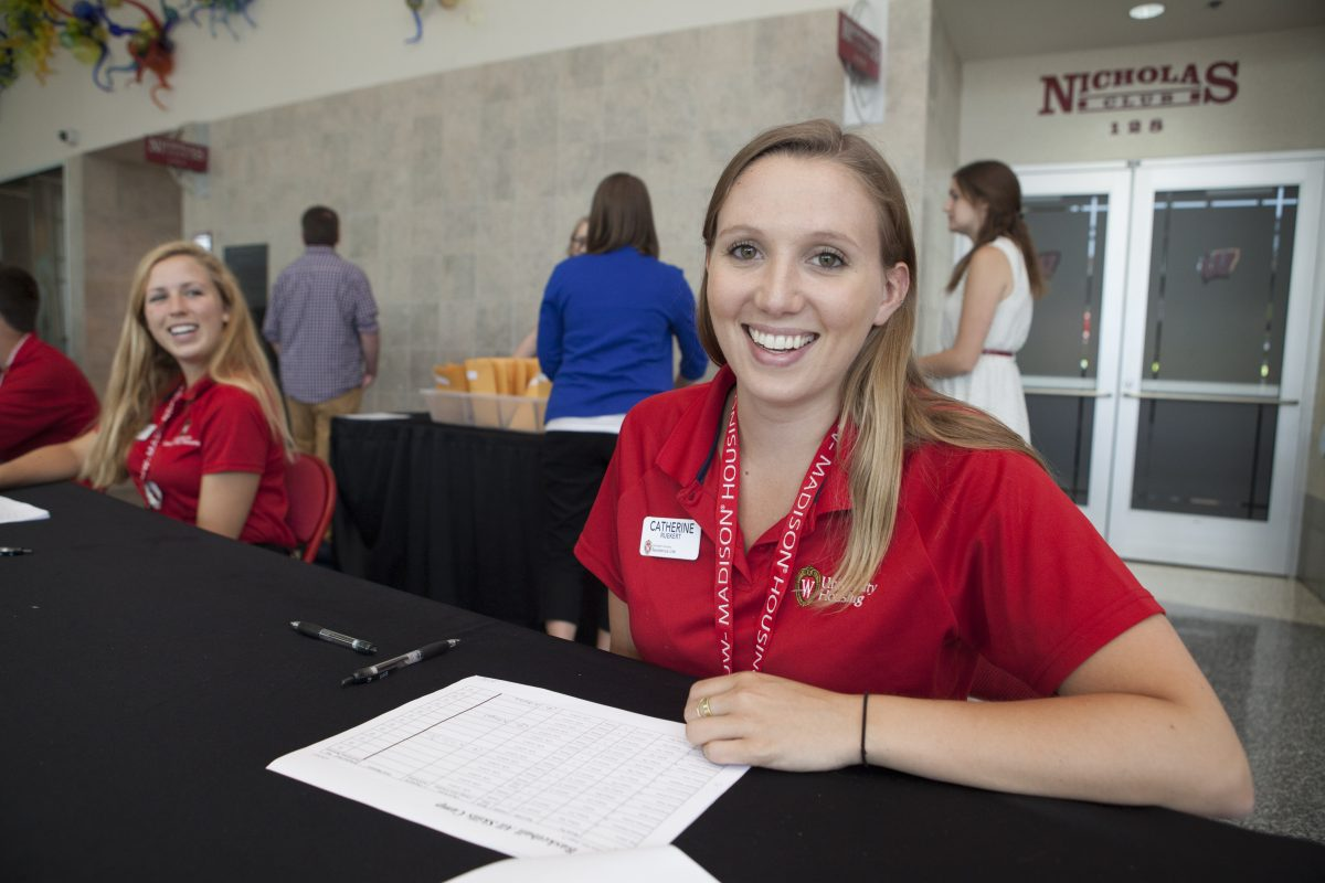 Desk services students run a check-in at the Kohl Center.