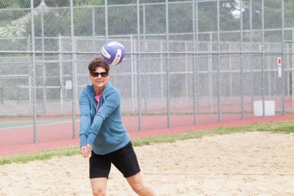 Woman hits volleyball outside Lakeshore residence halls
