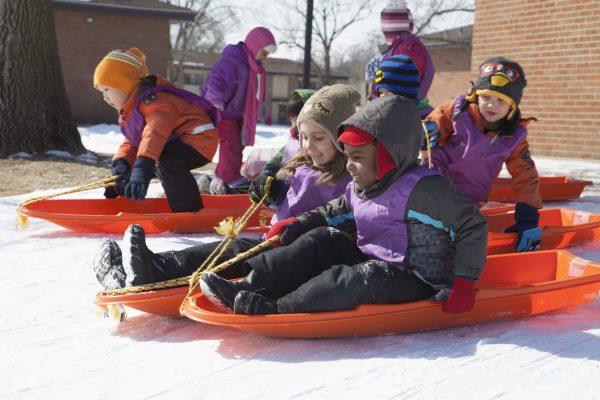 Eagle's Wing kids sledding.