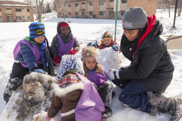 Eagle's Wing kids building a snow fort.