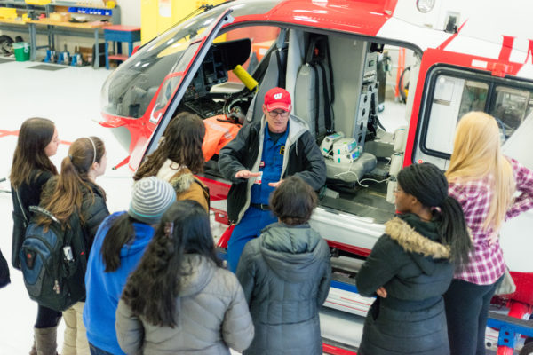 BioHouse students listening to a member of Med Flight give a tour of the Med Flight helicopter