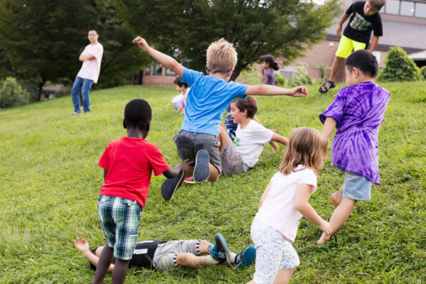 Kids playing during Eagle's Wing Peace Garden Picnic.
