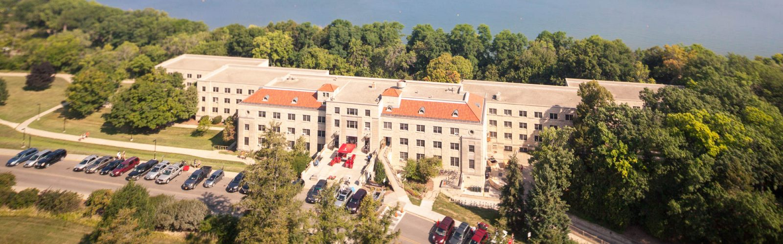 Vehicles line-up outside Waters Residence Hall o to unload during move-in