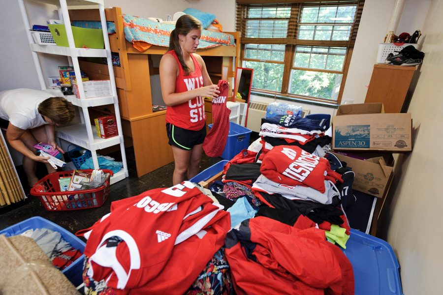 A new resident unpacks during move-in at Waters Residence Hall