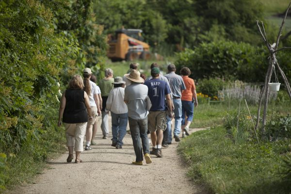 A group touring Eagle Heights garden.