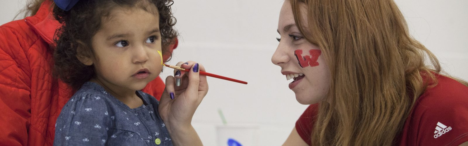 A girl gets her face painted at University Apartments' Wisconsin Fest.