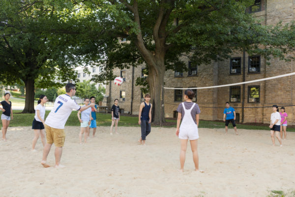 Youth campers play a volleyball game in the Lakeshore neighborhood