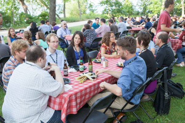 Guest enjoy a catered picnic by Lake Mendota, near Adams & Tripp Halls.