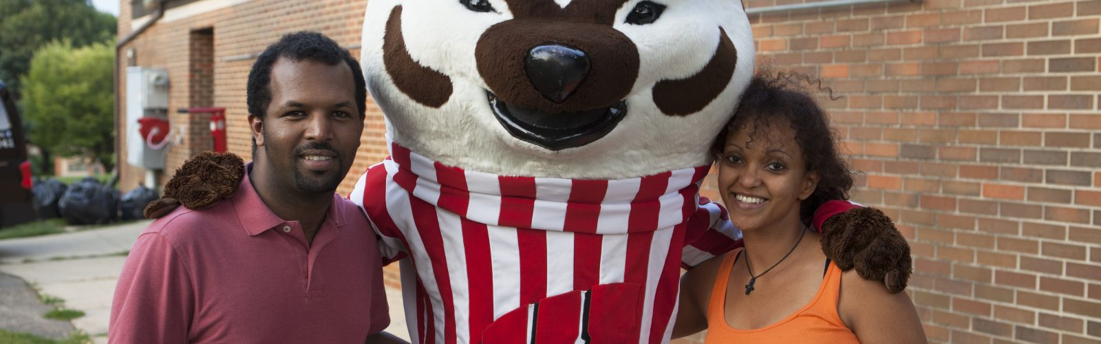 University Apartments residents take a photo with Bucky Badger.