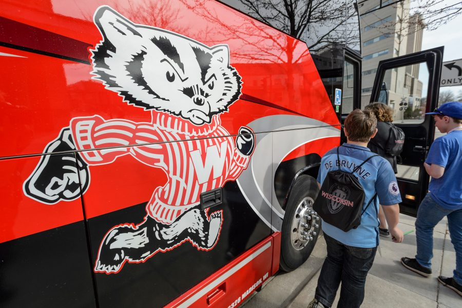 Participants of Siblings Day board a Badger Bus.