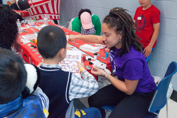 MLC residents volunteer in Eagle's Wing childcare center