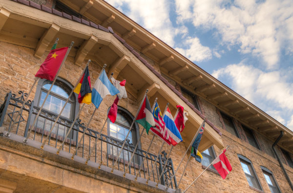ILC flags swaying outside their Lakeshore residence hall