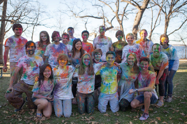ILS members pose covered in multicolor powder at their Holi Festival