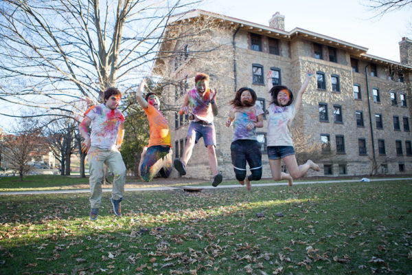 ILC members jumping in the air at their Holi Festival