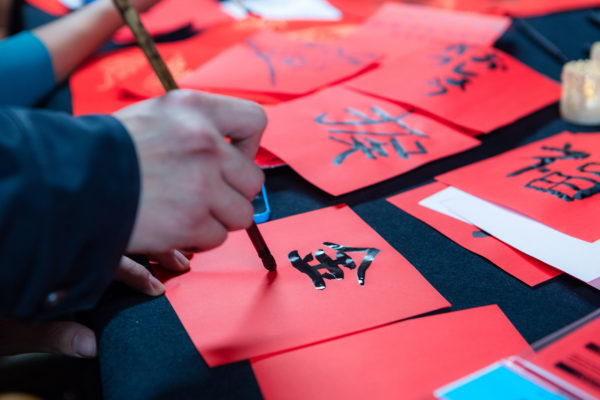 ILC resident painting Chinese characters in preparation Chinese New Year