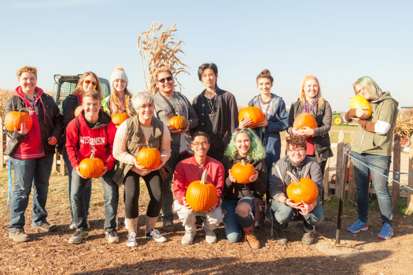 Open House residents pose with their freshly picked pumpkins at an outside orchard
