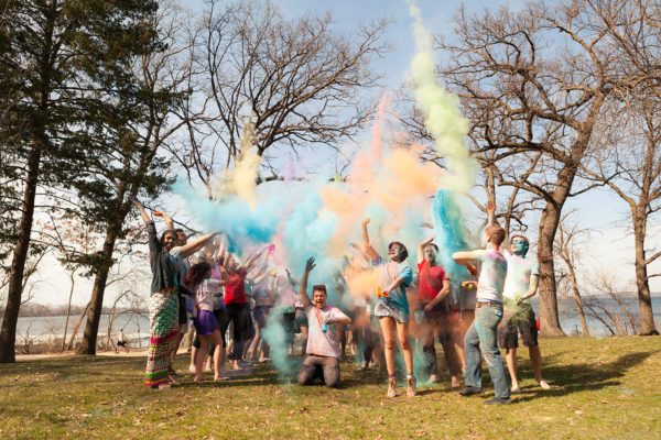 ILC members toss colored powder in the air as part of a Holi Festival