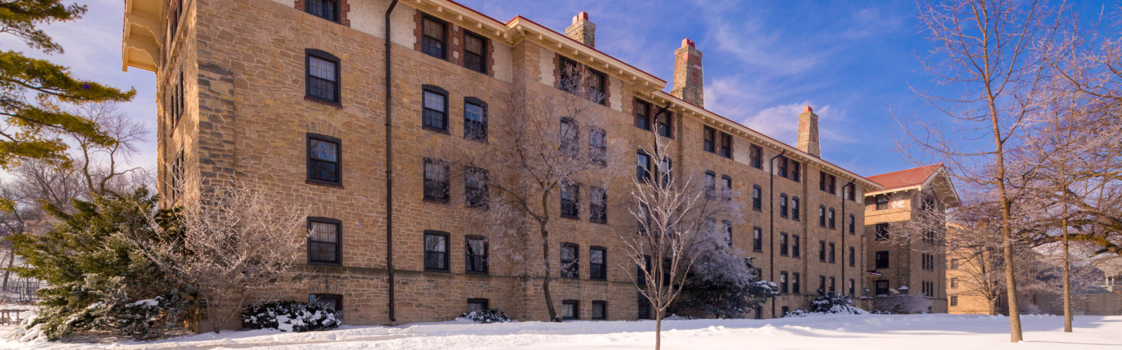 Tripp Residence Hall's exterior during winter