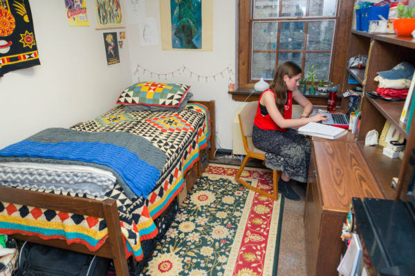 A student studies in her Tripp Residence Hall room