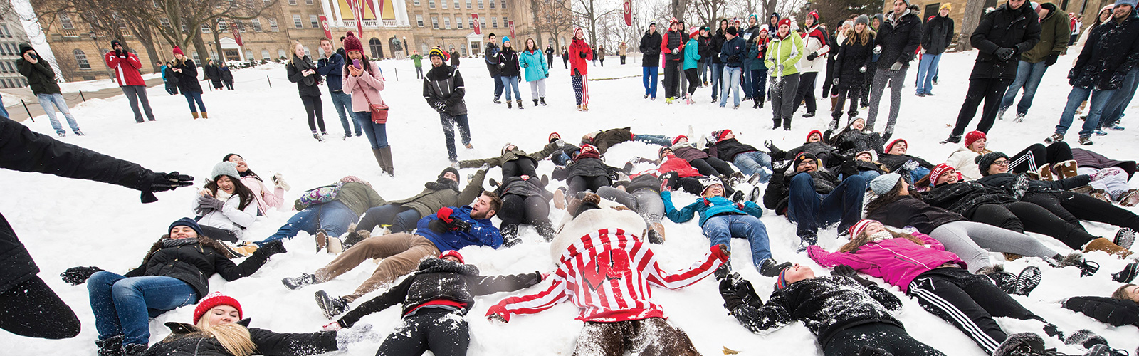 Students and Bucky in a campus snowball fight on Bascom Hill