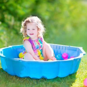 Toddler playing in kiddie pool