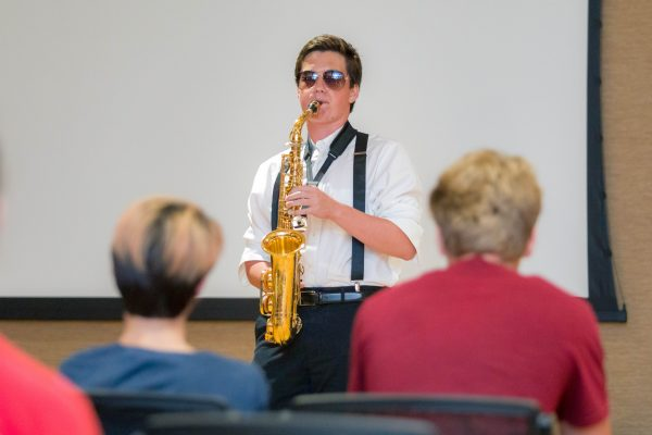 A guest playing a saxophone at the WCATY Talent Show