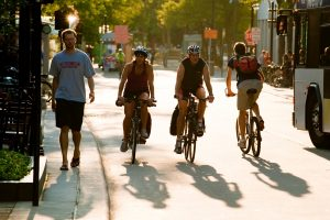 As the late-summer sun begins to set, silhouetted pedestrians and bicyclists make their way along State Street near the University of Wisconsin-Madison campus on Sept. 3, 2009. ©UW-Madison University Communications 608/262-0067 Photo by: Jeff Miller Date: 09/09 File#: NIKON D3 digital frame 8651